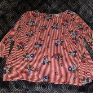 Red and white pinstripe blouse with flowers.